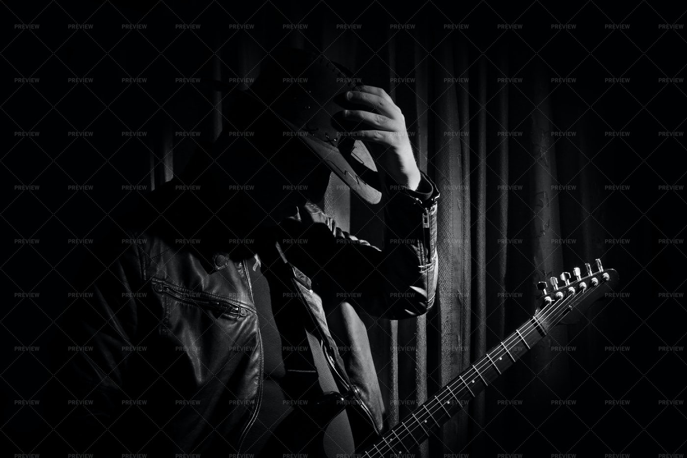 Guitarist In The Shadows: Stock Photos
