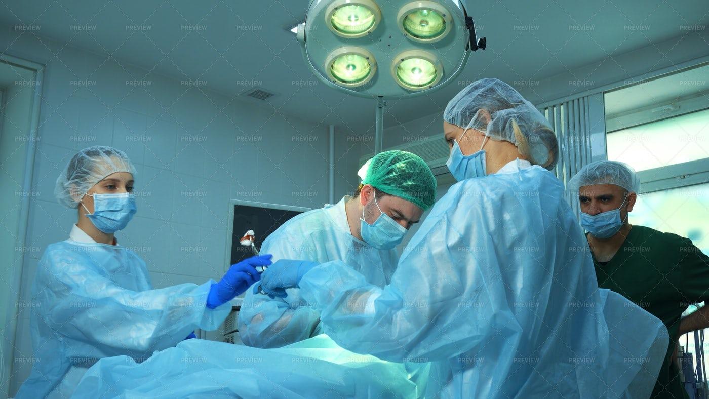 Surgeons At Work: Stock Photos