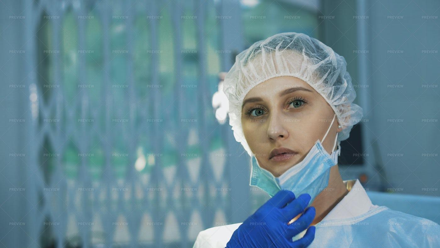 Surgeon Pulling Mask Down: Stock Photos