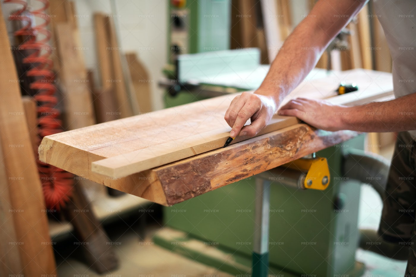 Carpenter Measures Wooden Block: Stock Photos