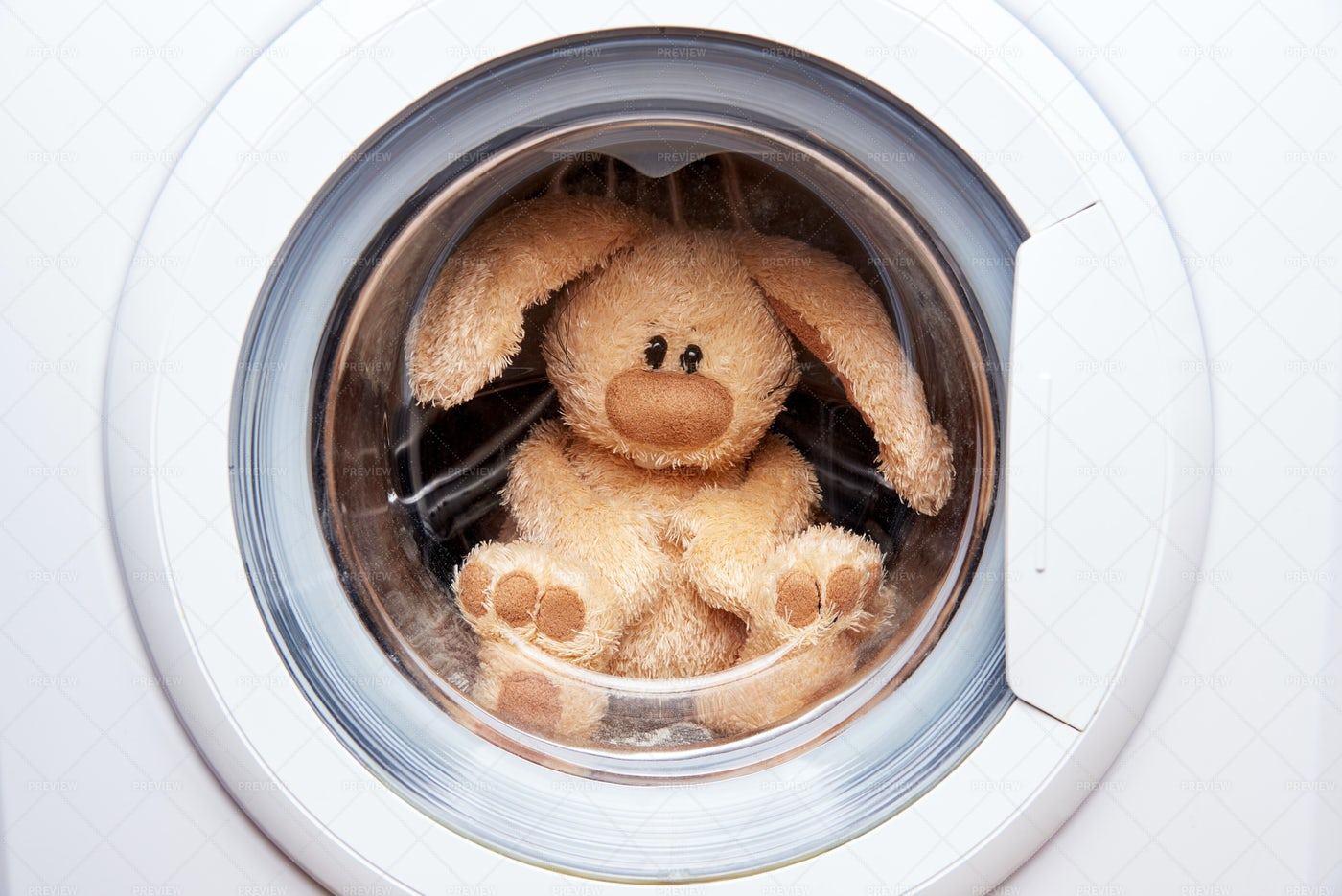Rabbit Toy In The Laundry.: Stock Photos