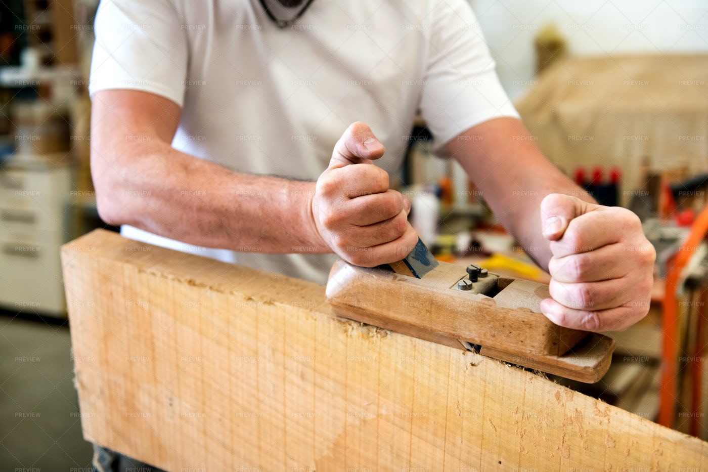 Carpenter Planing A Surface: Stock Photos