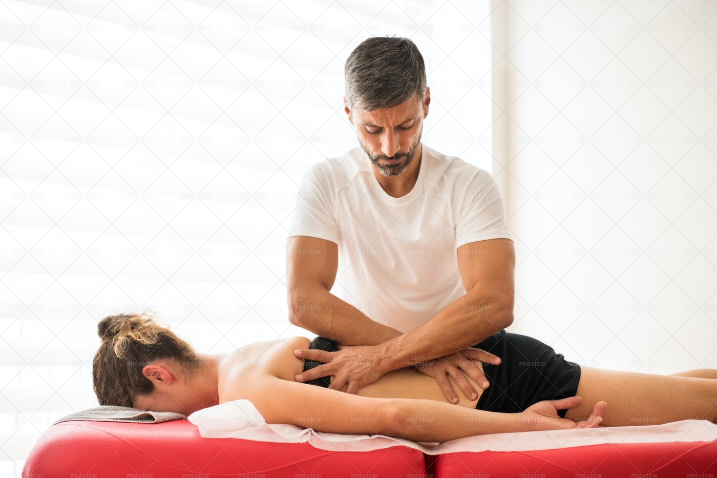 Osteopath Performing Treatment: Stock Photos
