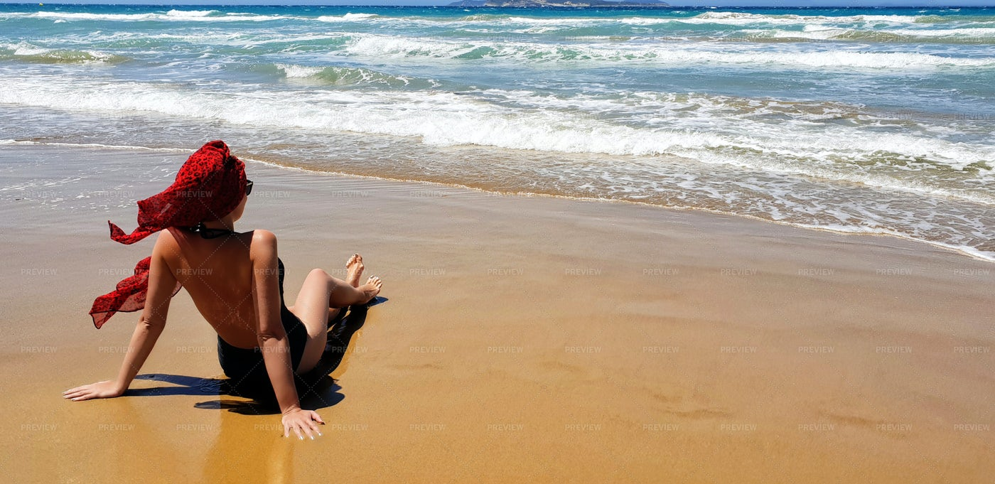 Woman Watches The Waves: Stock Photos