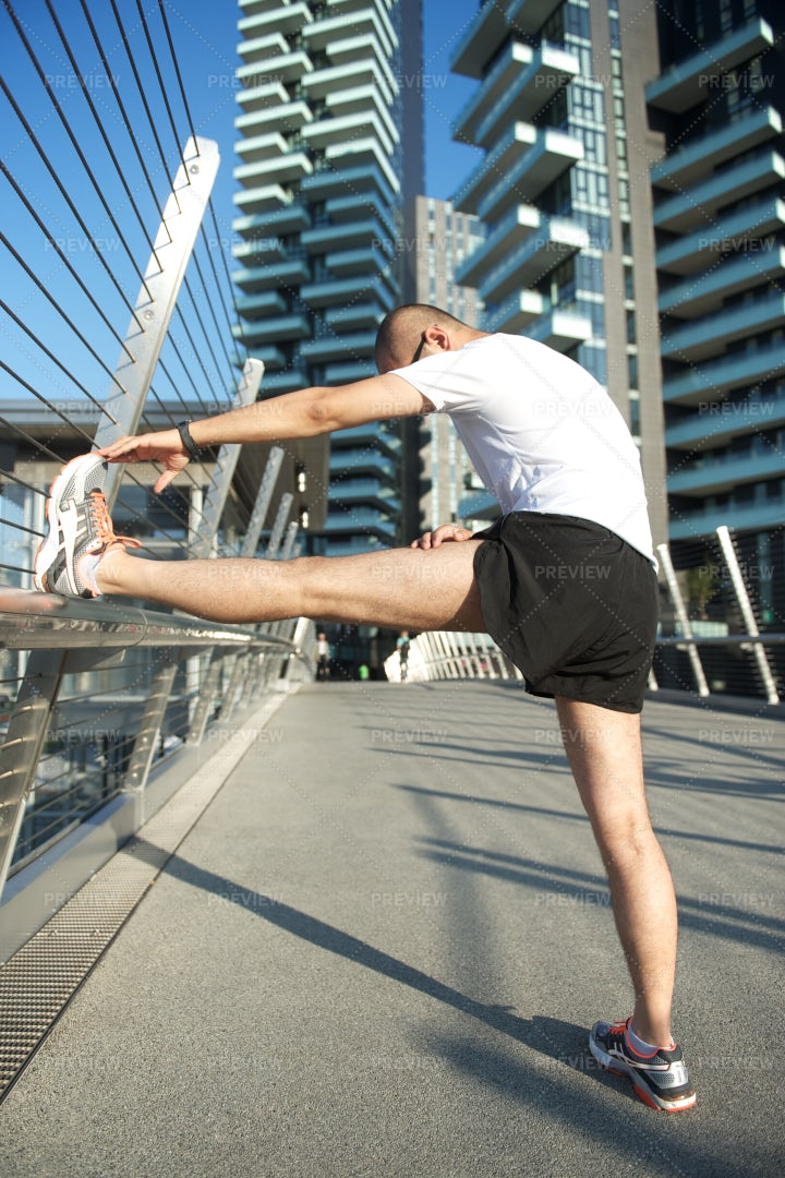 Stretching Before Running: Stock Photos