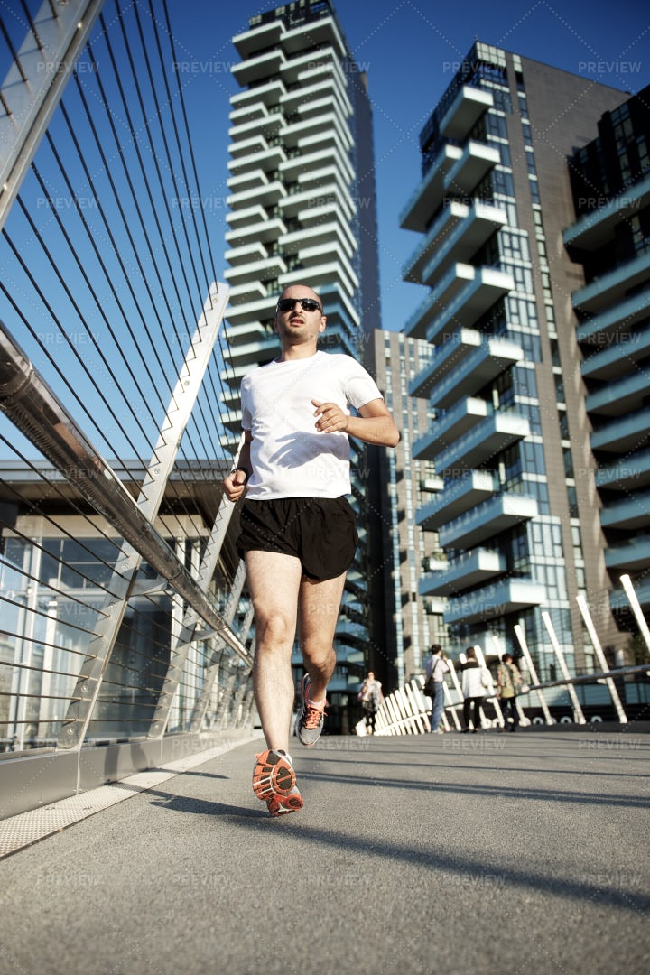 Man Running In City: Stock Photos