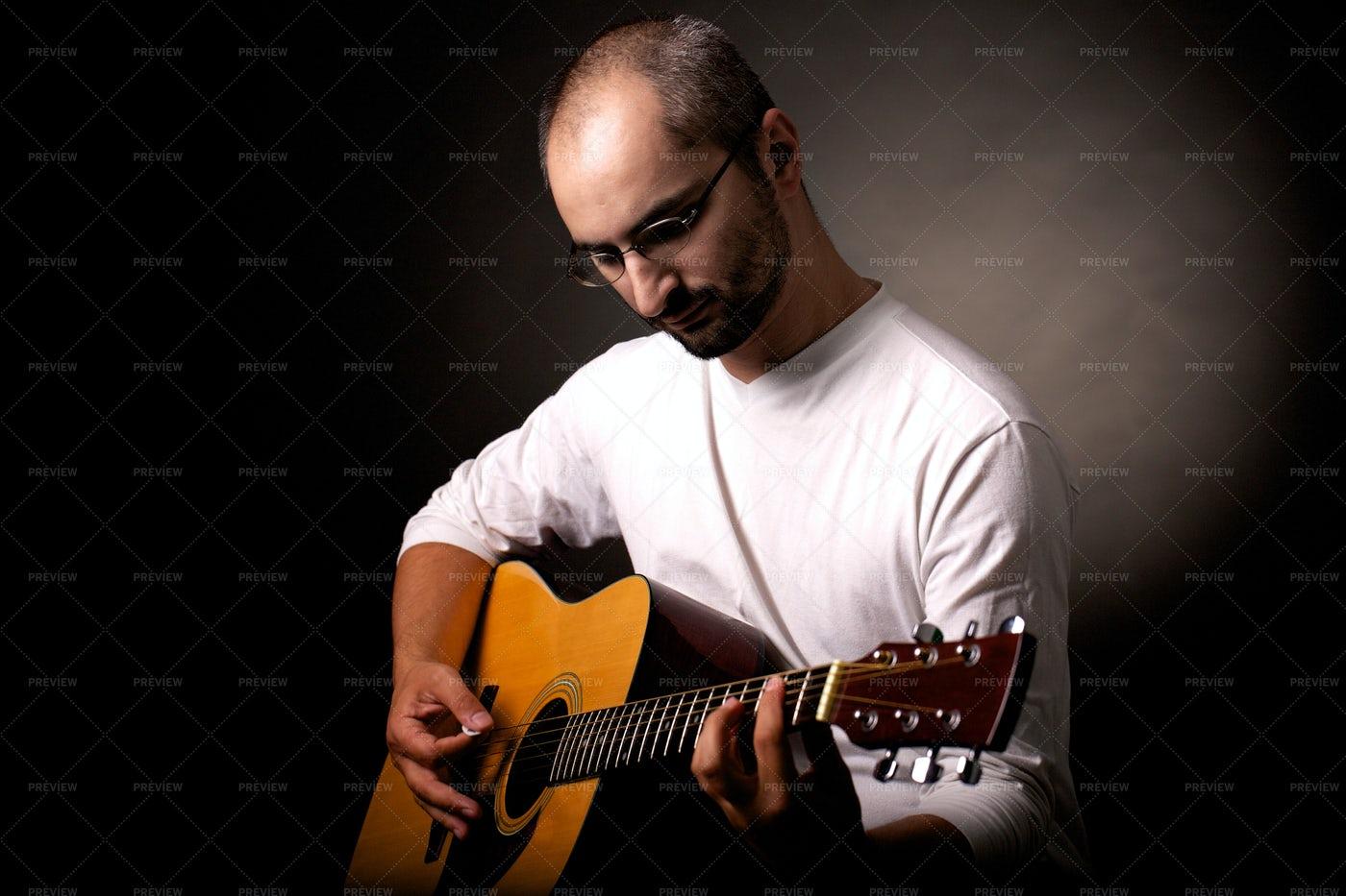 Playing Acoustic Guitar: Stock Photos