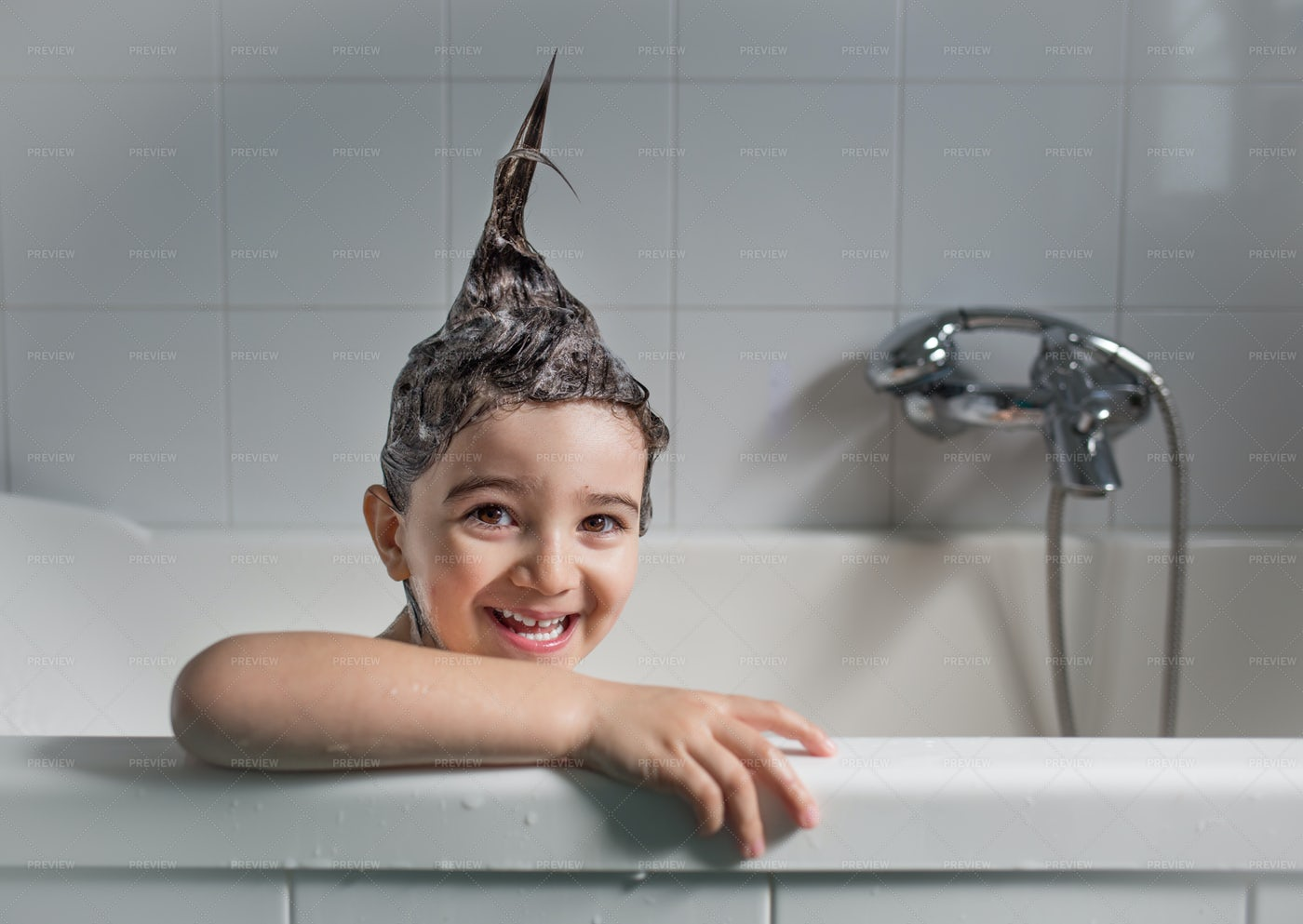 Smiling Child In A Bathtub: Stock Photos