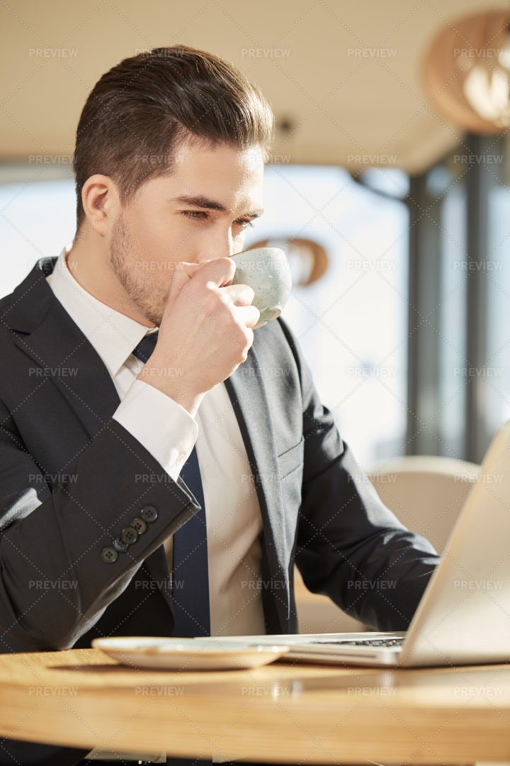 Young Man Drinking Coffee: Stock Photos