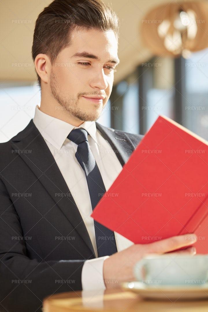 Man Reading At A Cafe: Stock Photos