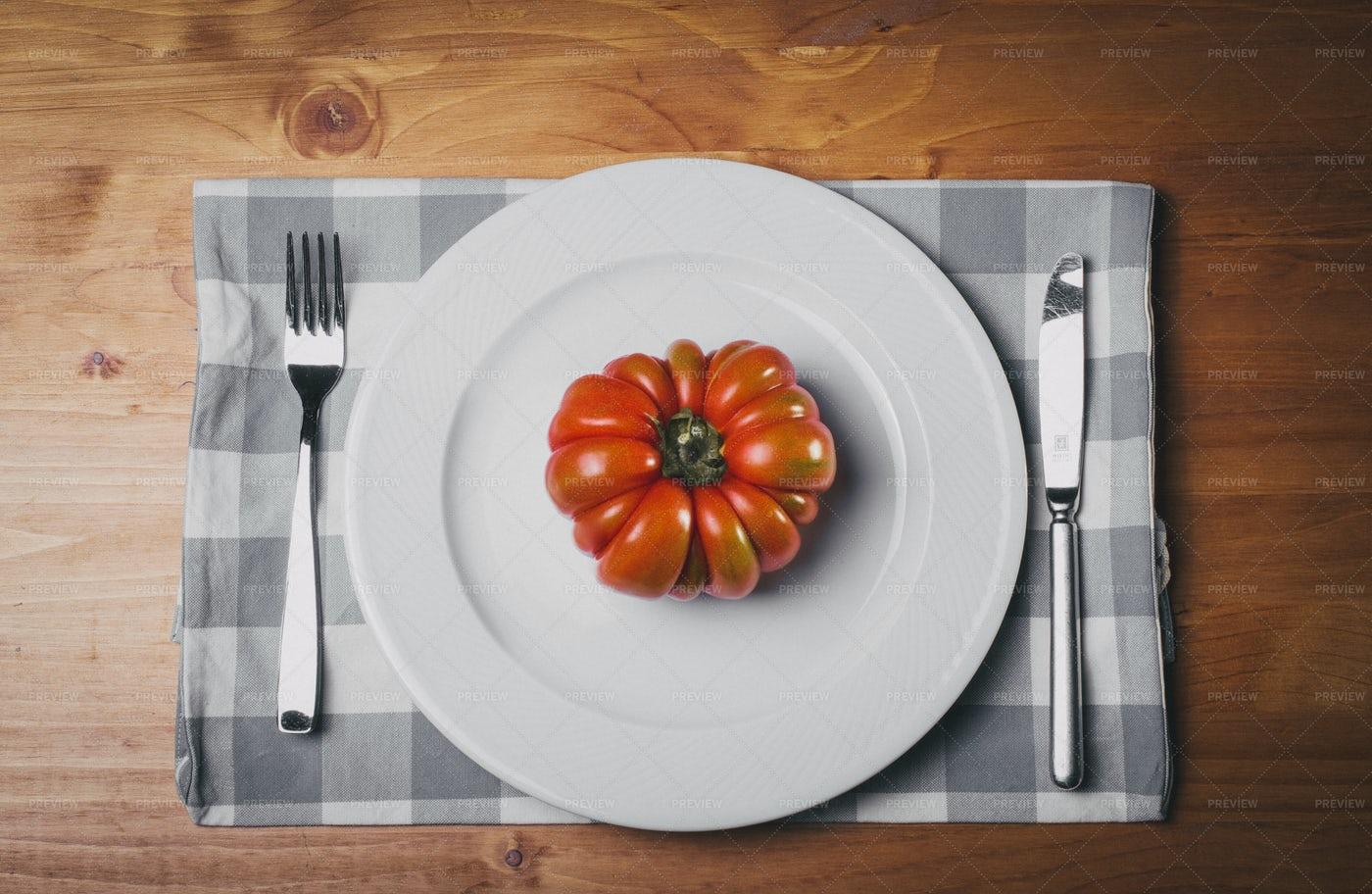 Tomato On White Plate: Stock Photos