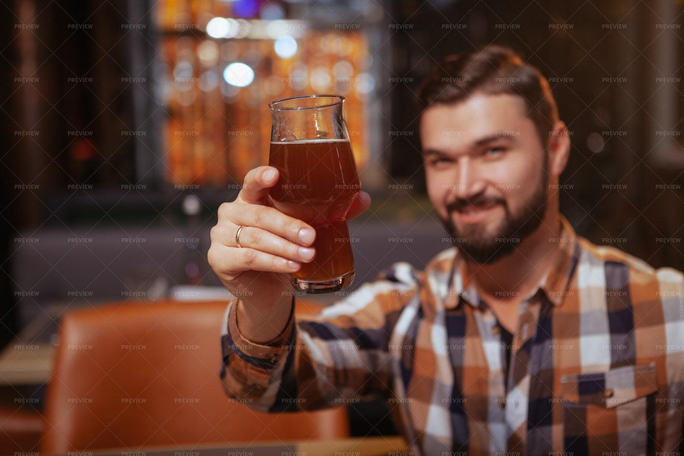 Man Raises A Beer: Stock Photos