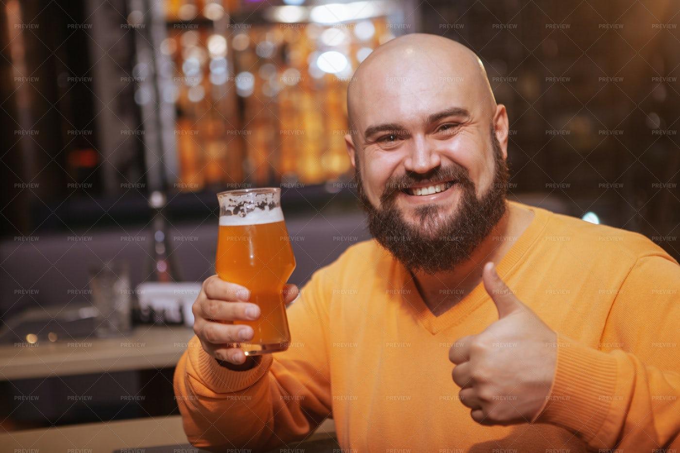 Thumbs Up At A Bar: Stock Photos