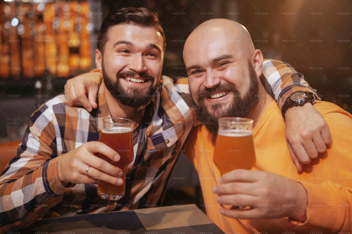 Best Friends Share Beers: Stock Photos