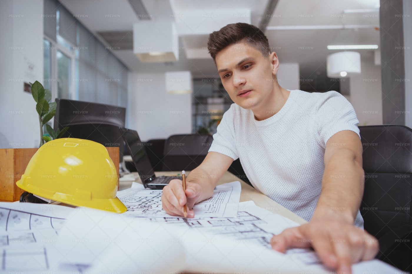 Busy With His Blueprints: Stock Photos