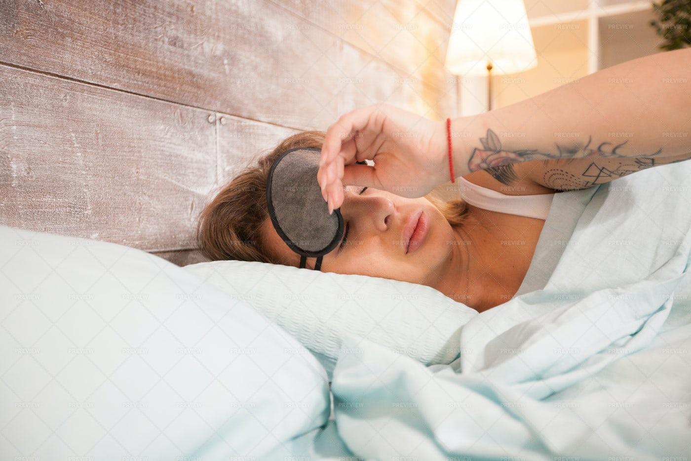 Pulling Her Sleeping Mask: Stock Photos