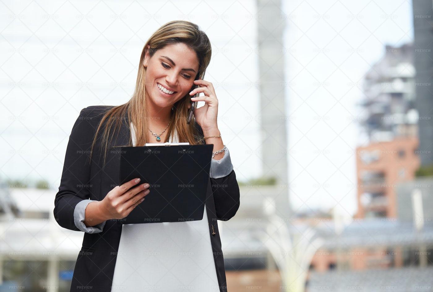 Businesswoman Discusses Notes: Stock Photos