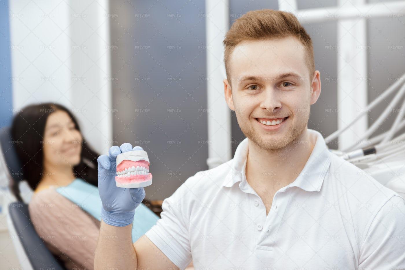 Dentist Shows Mold: Stock Photos