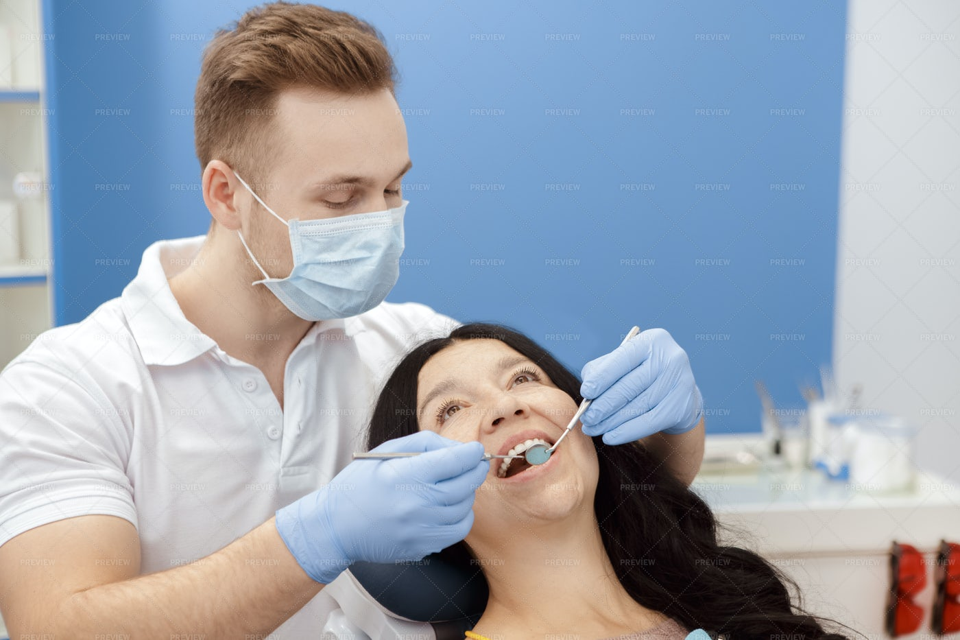 Dentist Working With Patient: Stock Photos