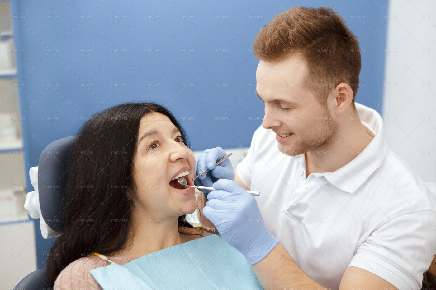 Dentist Performs A Check-Up: Stock Photos