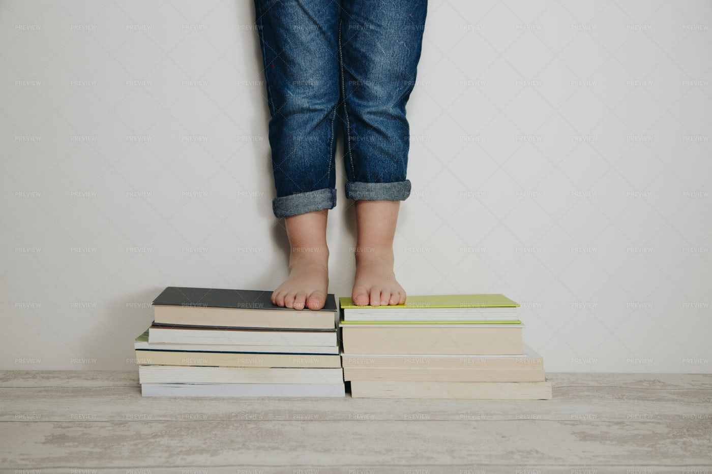 Child Standing On Books: Stock Photos