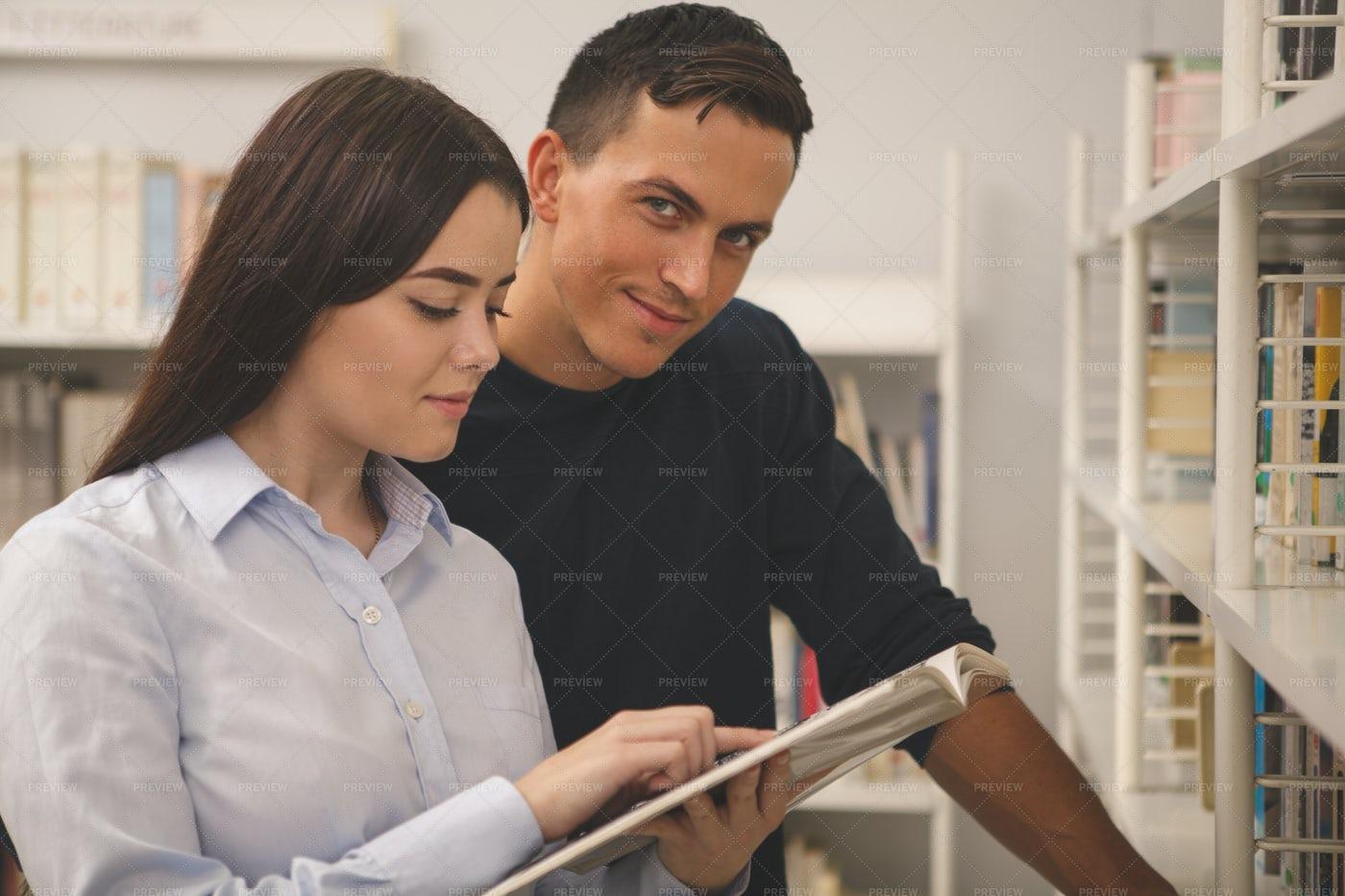 Couple Reading Through Book: Stock Photos