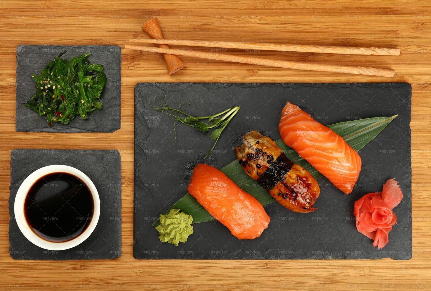 Three Nigiri Sushi With Salmon And Eel: Stock Photos