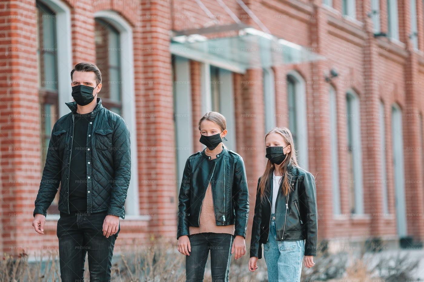 Masked Family On A Walk: Stock Photos