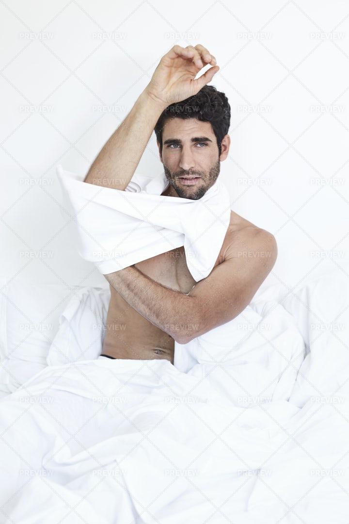 Undressing Guy: Stock Photos
