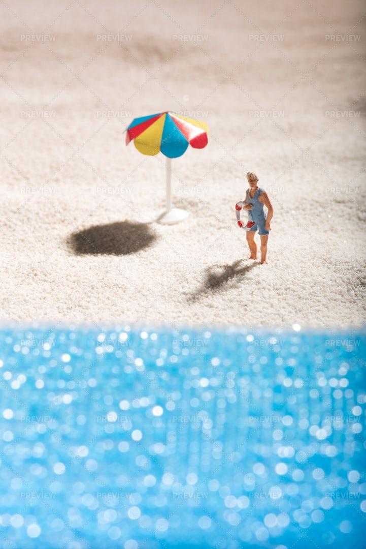 Miniature Lifeguard On The Beach: Stock Photos