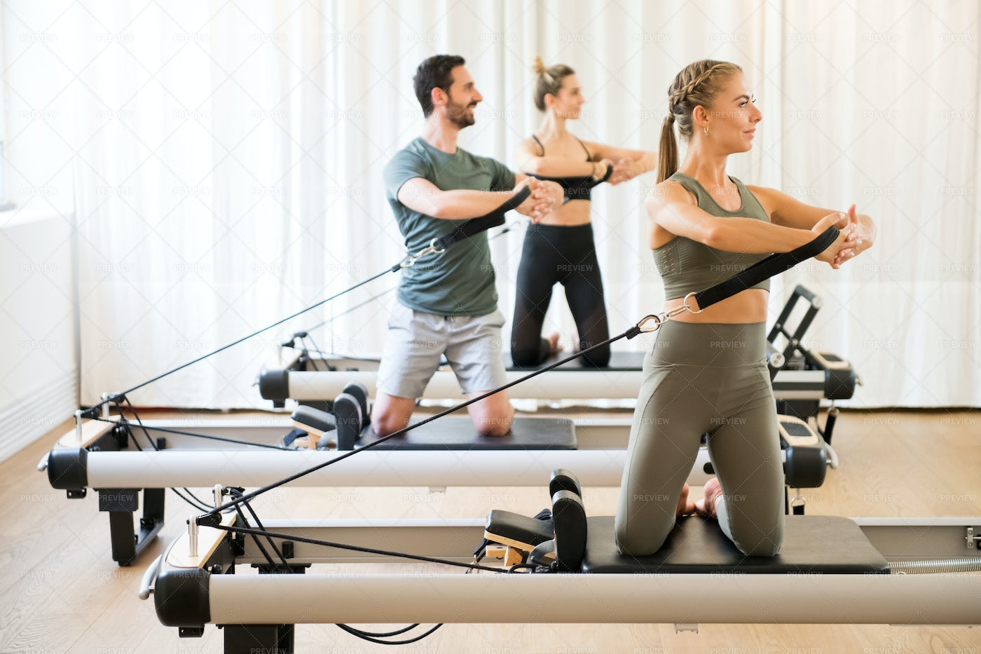 Exercising With Reformer Beds: Stock Photos