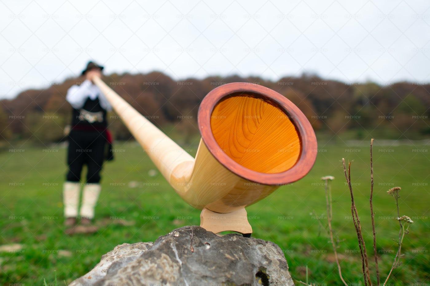 Man Playing An Alp Horn: Stock Photos