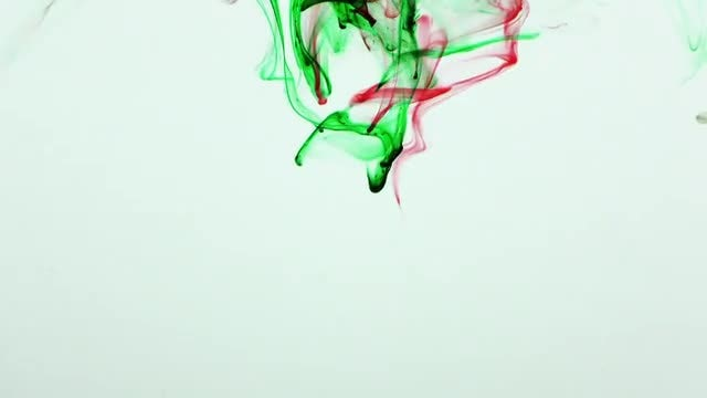 Red and Green Ink Splash: Stock Video