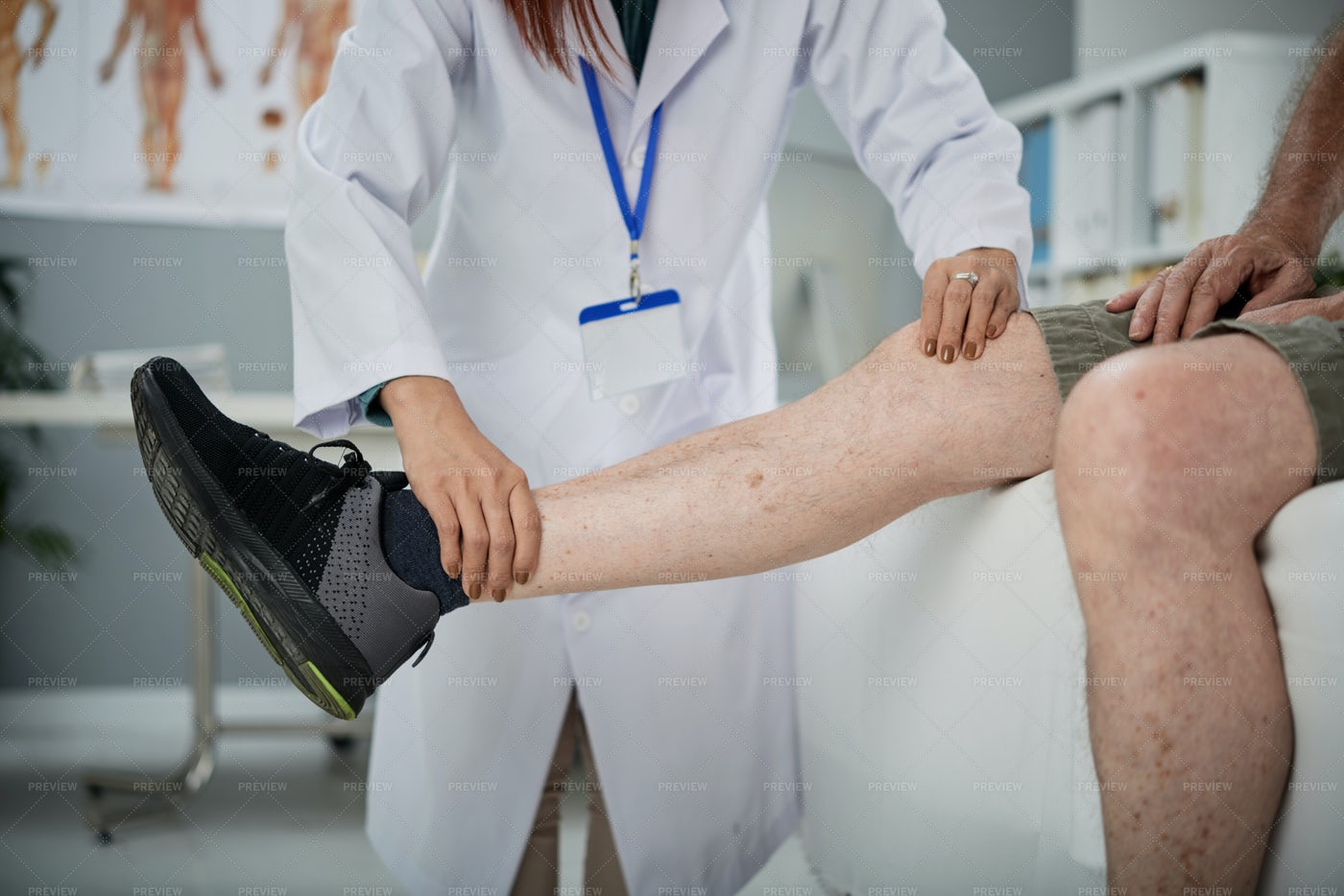 Physiotherapist Palpating Leg: Stock Photos