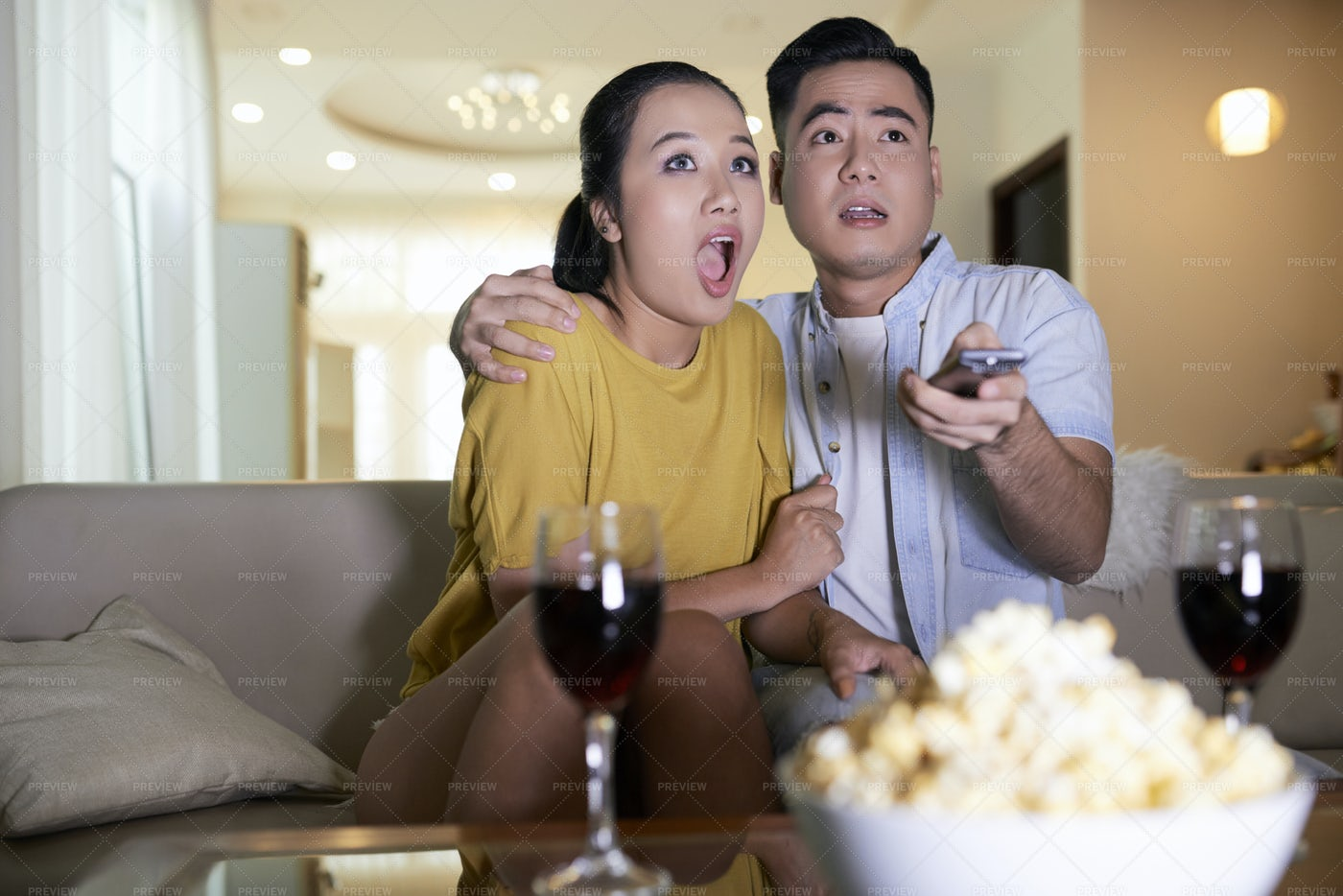 Couple Watching Scary Movie At Home: Stock Photos