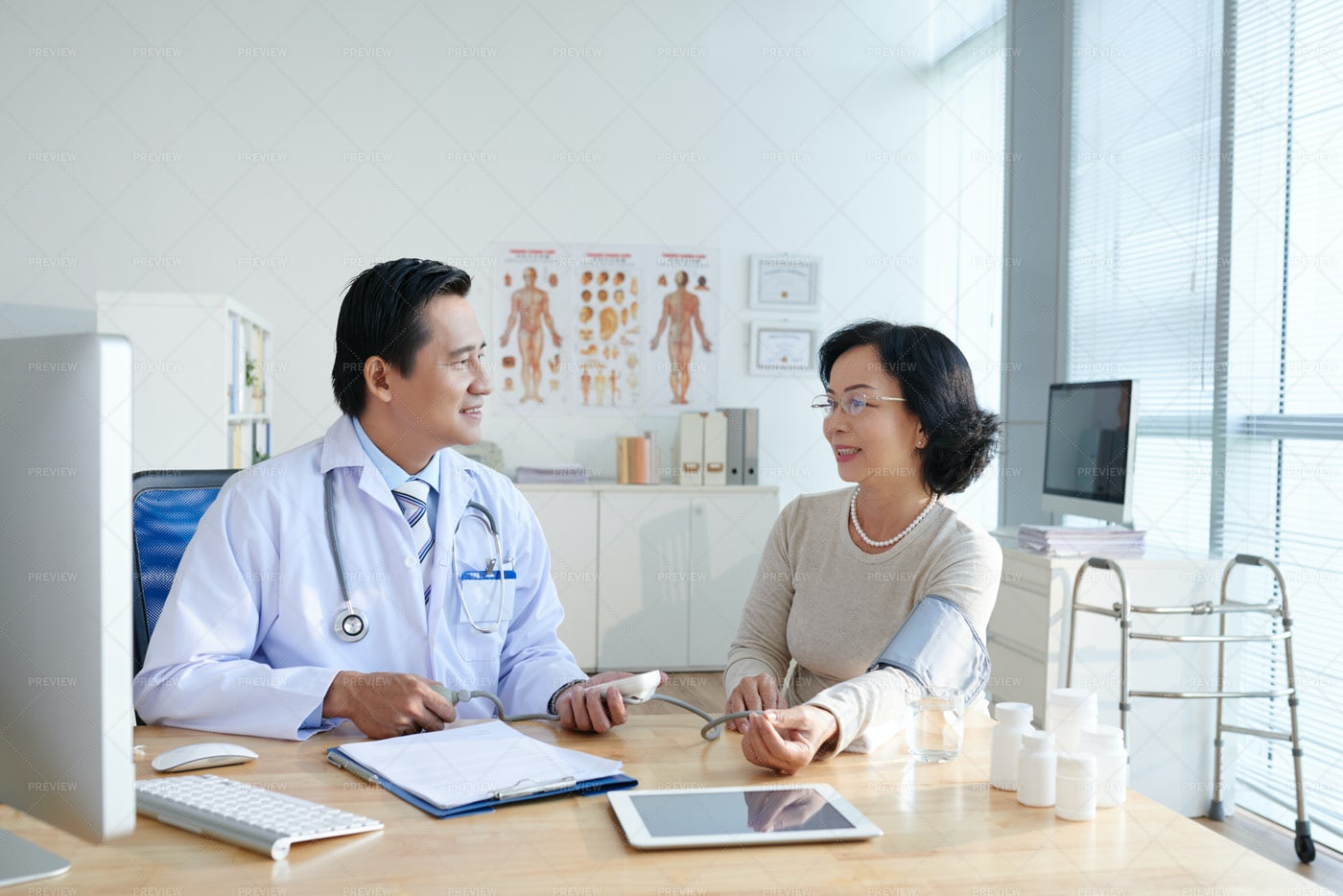 Measuring Blood Pressure Of Patient: Stock Photos