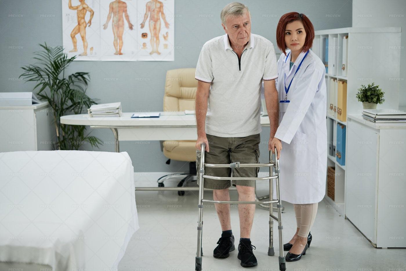 Therapist Helping Patient: Stock Photos