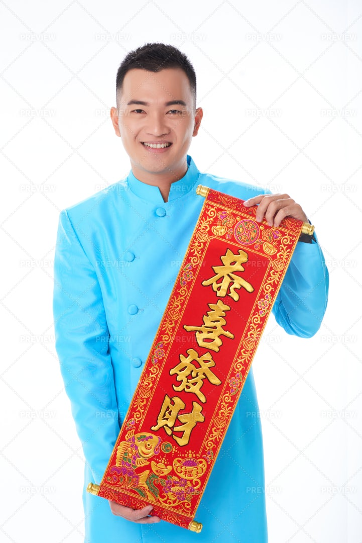 Young Man With Red Scroll: Stock Photos