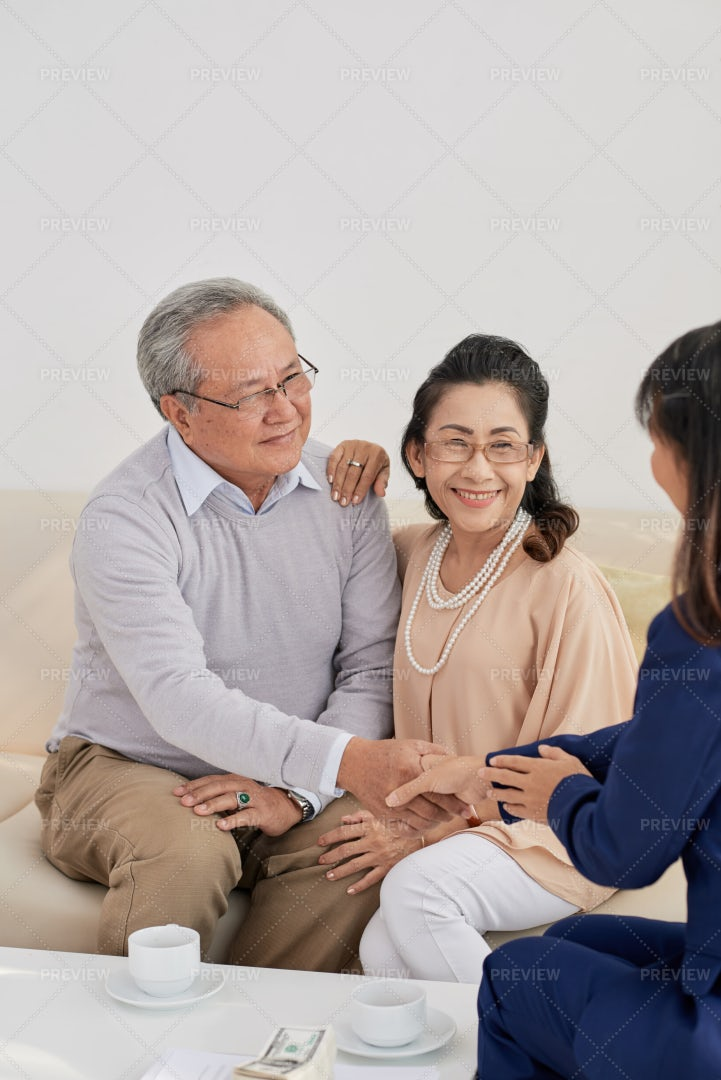 Aged Couple Meeting With Financial...: Stock Photos