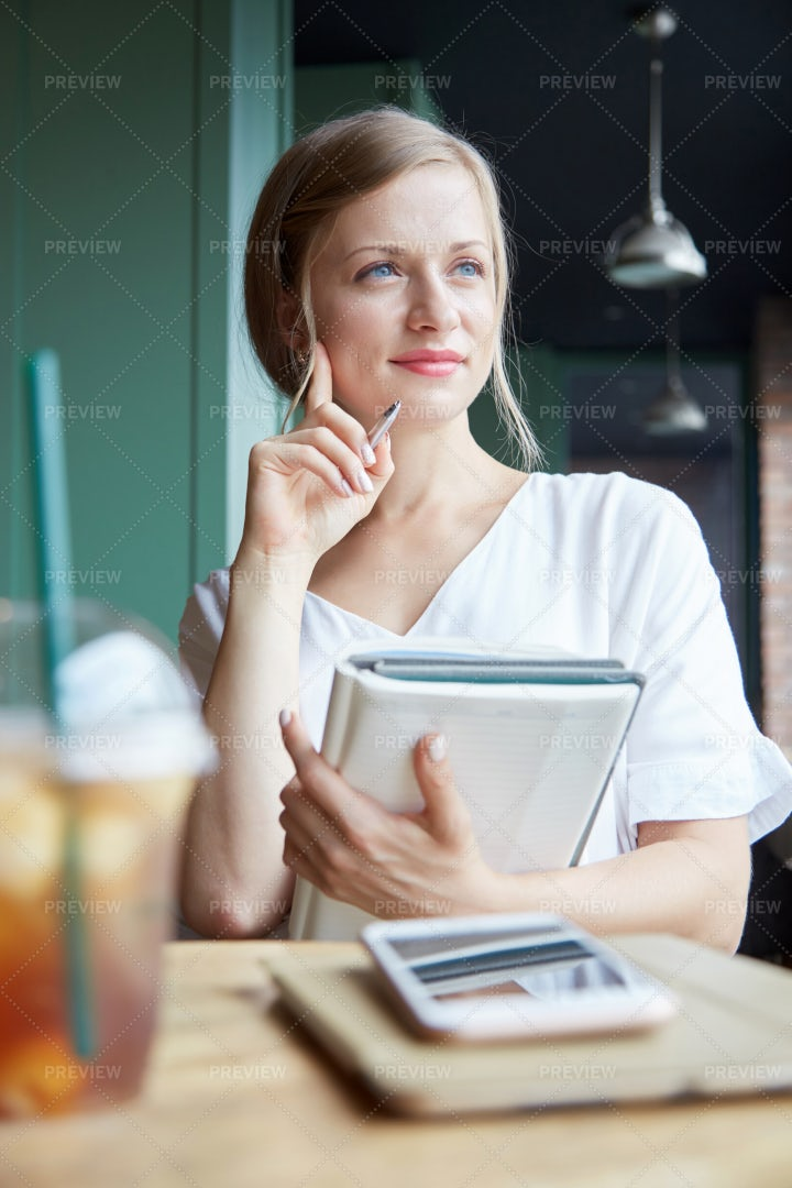 Pensive Student In Cafe: Stock Photos