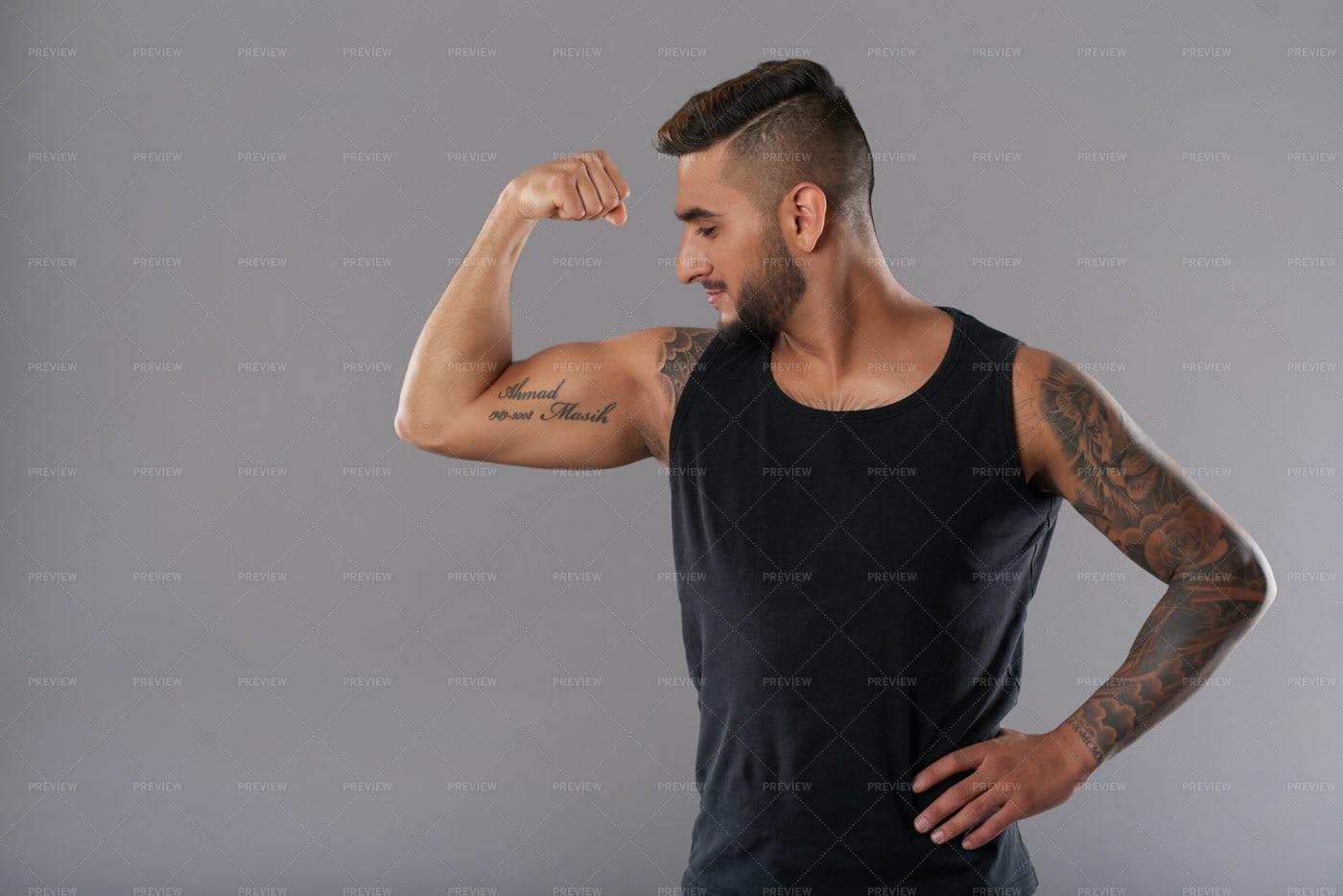 Confident Athlete Showing Bicep...: Stock Photos