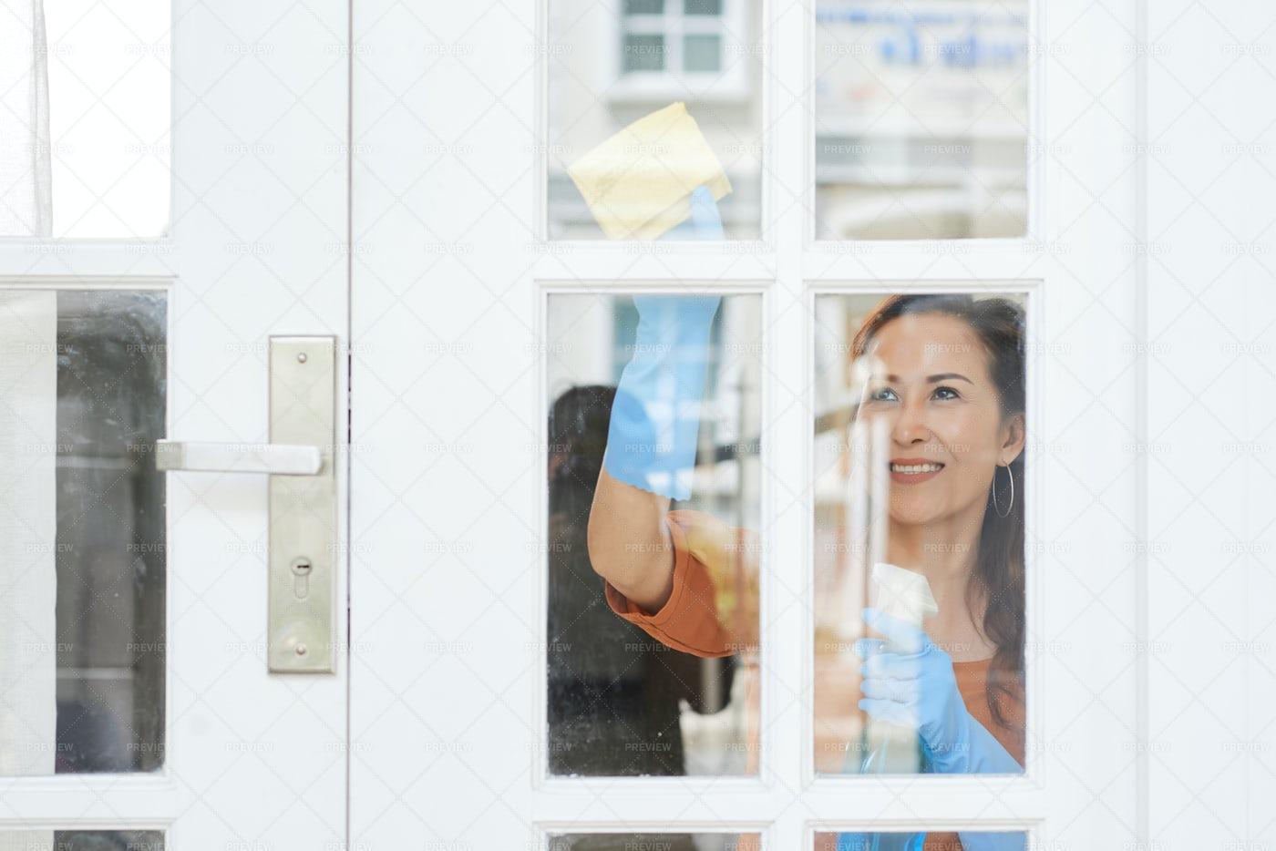 Housewife Cleaning Door: Stock Photos