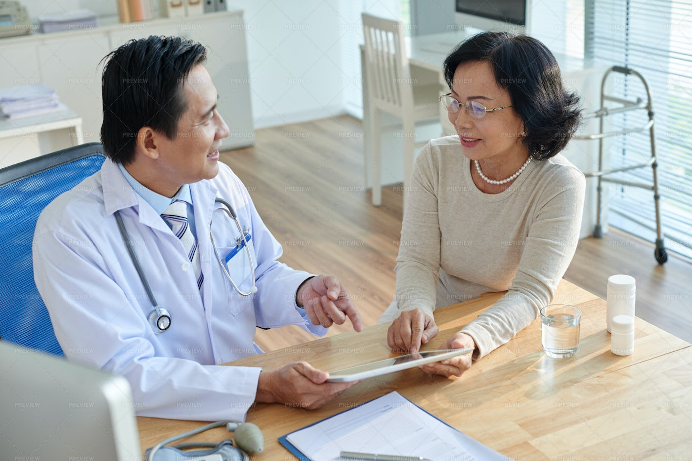 Showing Test Results To Patient: Stock Photos