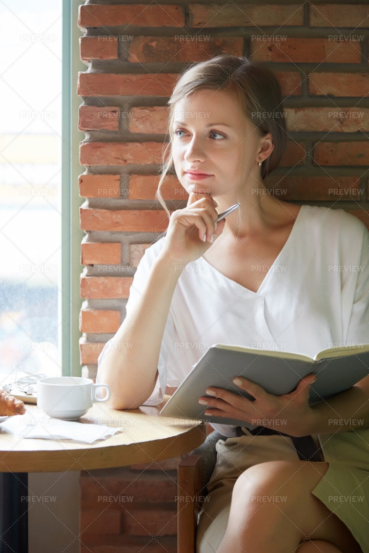 Pensive Businesswoman In Cafe: Stock Photos