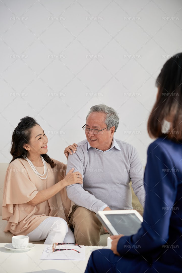 Aged Couple Meeting With Adviser: Stock Photos