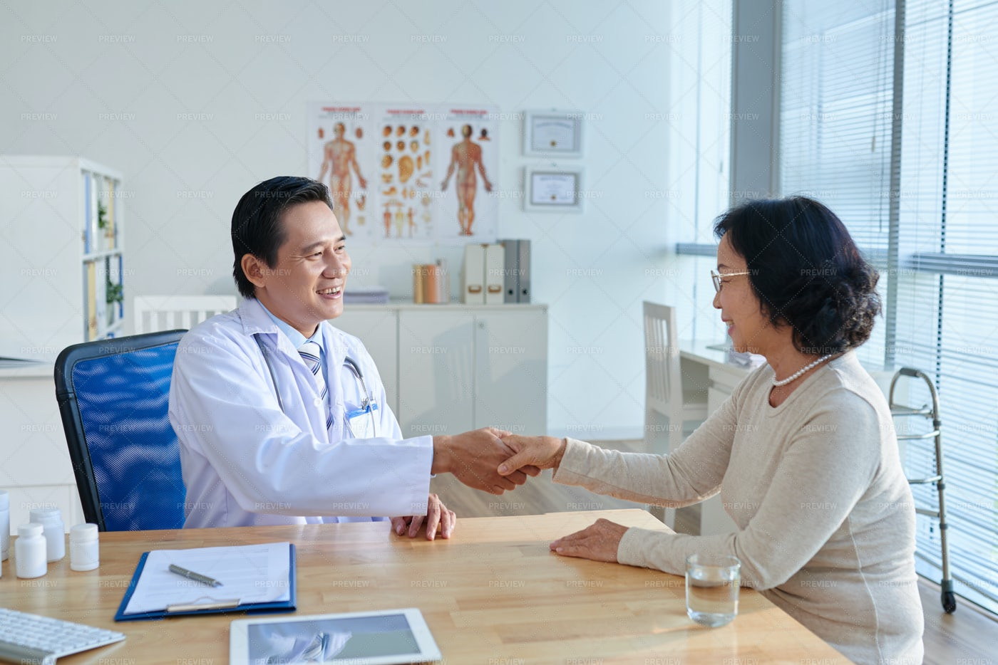 Shaking Hand Of Middle-aged Doctor: Stock Photos