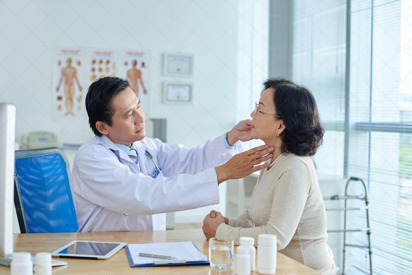 ENT Specialist Examining Patient: Stock Photos