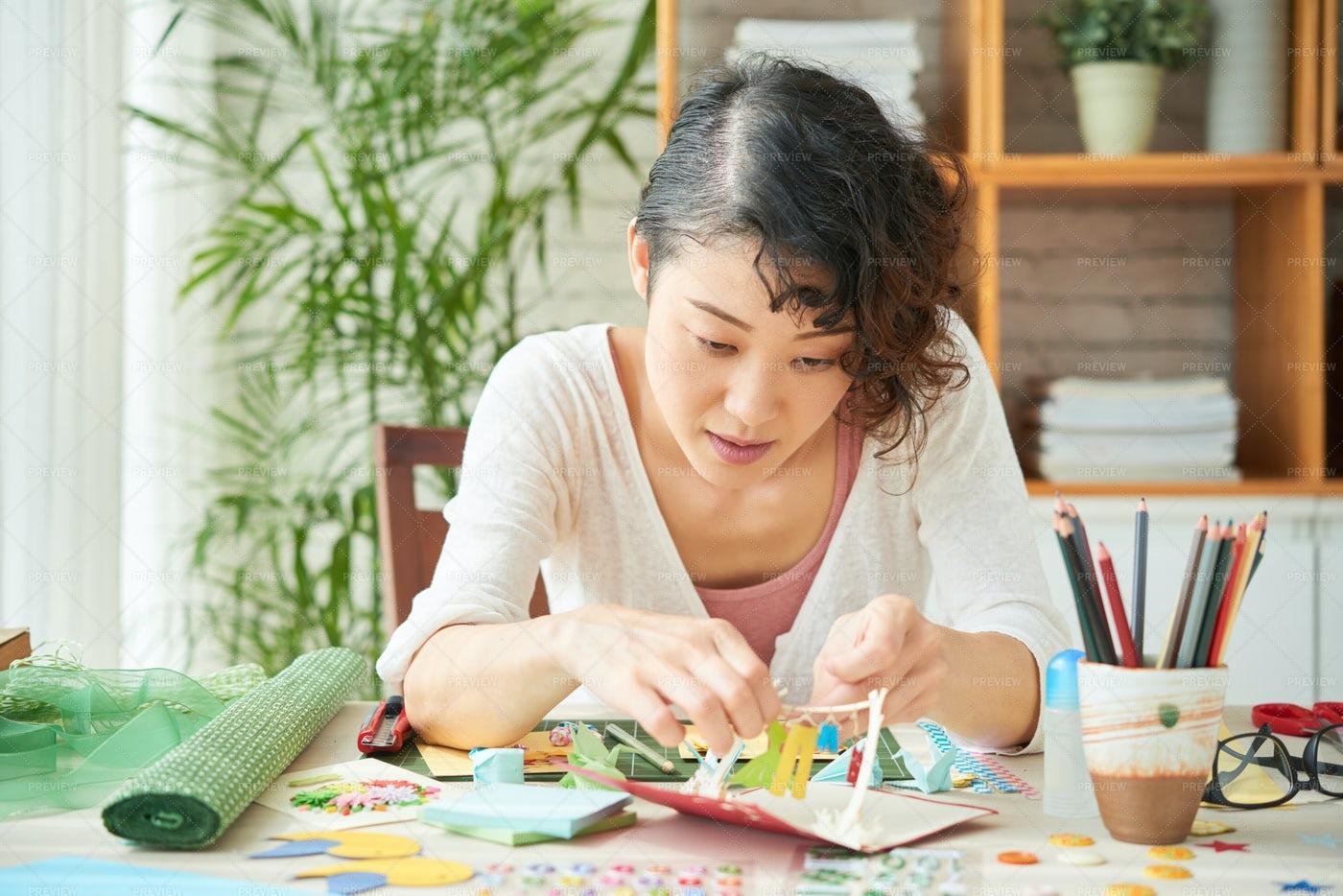 Japanese Woman Focused On...: Stock Photos