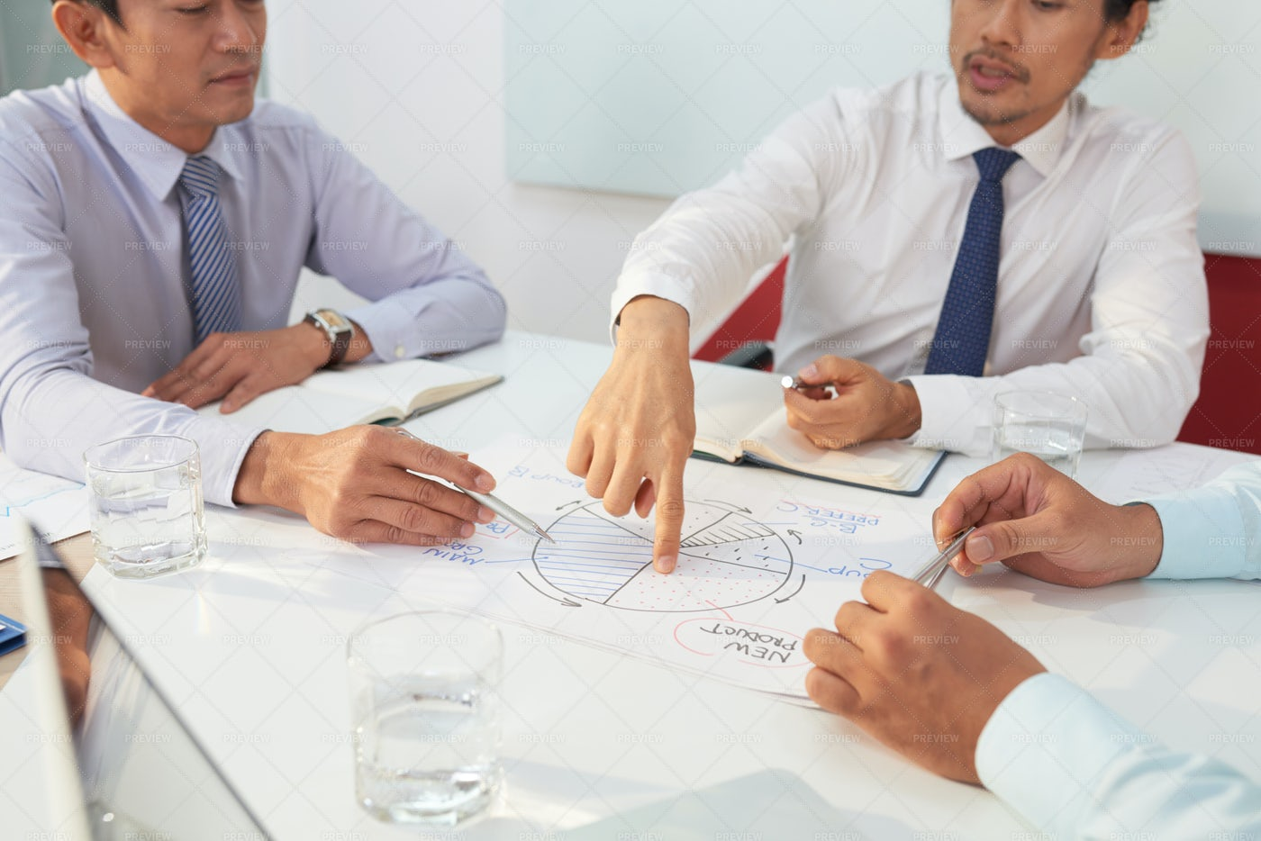 Discussing Business Chart: Stock Photos