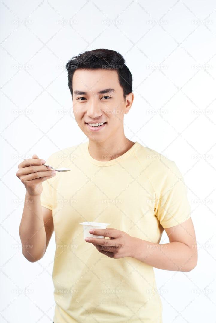 Man Eating Yogurt: Stock Photos